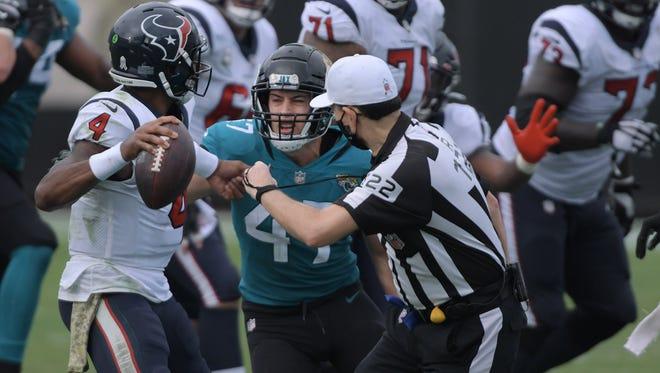 Jaguars linebacker Joe Schobert pressures Houston quarterback Deshaun Watson last Sunday at TIAA Bank Field.