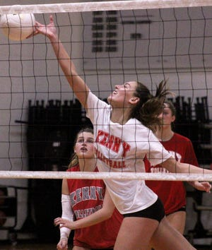 Bishop Kenny senior middle hitter Ashton Dilts leaps for a shot during practice on Monday ahead of the Class 4A volleyball finals.