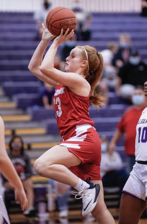 Glen Rose's Abby Stephenson drives to the basket against Alvarado.