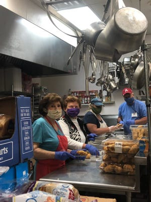 Grand Central Station volunteers work to prepare food