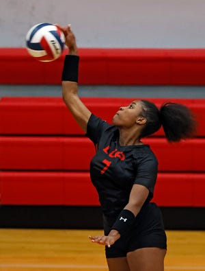 Lubbock-Cooper's D'Leah Hill (7) hits the ball over the net during the match against Monterey, Tuesday, Nov. 10, 2020, in Woodrow, Texas.
