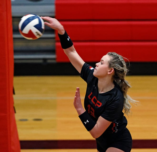 Lubbock-Cooper's Tatum Farmer (13) hits the ball over the net during the match against Monterey, Tuesday, Nov. 10, 2020, in Woodrow, Texas.
