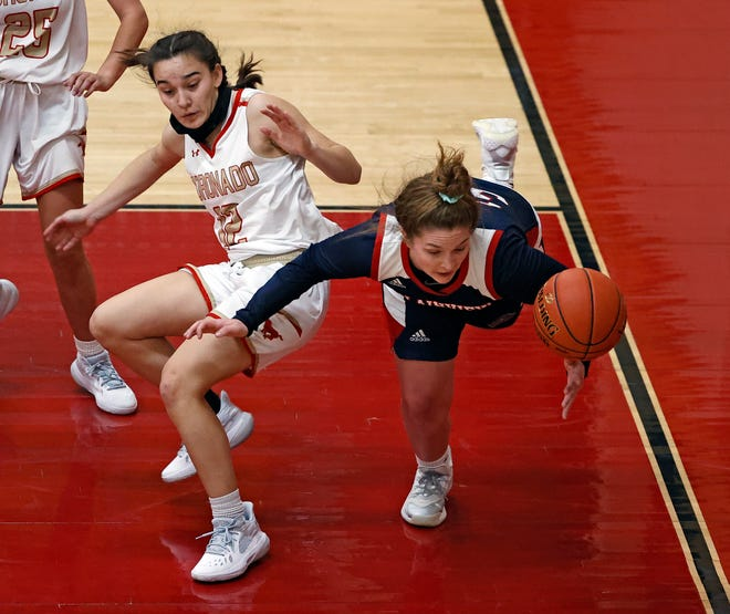 Coronado's Jazlyn Braithwaite (12) and Plainview's Kylie Bennett (30) run into each other during the game against Plainview, Tuesday, Nov. 10, 2020, in Woodrow, Texas.
