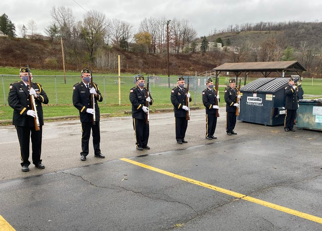 Pictured is the Veterans of Foreign Wars Honor Guard Ritual Team along with bugler Chubb Hawkins (far right)