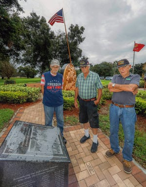 (L-R) Jim Thompson , Air Force in Viet Nam 1967-68 and part of 1969,  Sanford Trousdale, Marines in Viet Nam 1968-69, and Bud Maenner, Army in Viet Nam 1968, by the Viet Nam Veterans Memorial at Frank C. Gardner Park and Veterans Memorial  in Lake Alfred.