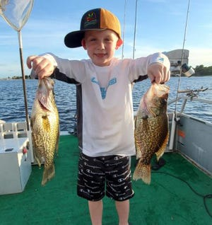 Kale McCloughen, 7, of Babson Park caught these speckled perch while fishing at Crooked Lake recently.
