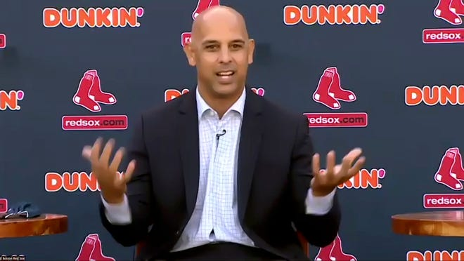 Manager Alex Cora speaks Tuesday at Fenway Park in Boston. Cora, who led the Red Sox to the 2018 World Series title, was rehired as manager less than a year after the team let him go because of his role in the Houston Astros' cheating scandal.