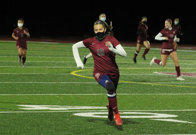 Westborough senior Emma Mumby, shown chasing a ball during a game earlier this season, scored during the shootout against Wachusett Tuesday night. The Rangers defeated the Mountaineers to advance to the Pod 8 Finals against Algonquin on Thursday.
