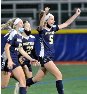 Katrina Marten (5), Zoey Payne (21) and Tori Brooks celebrate the clinching penalty kick goal for Marcus Whitman in Tuesday's Class C1 match against Canisteo-Greenwood.