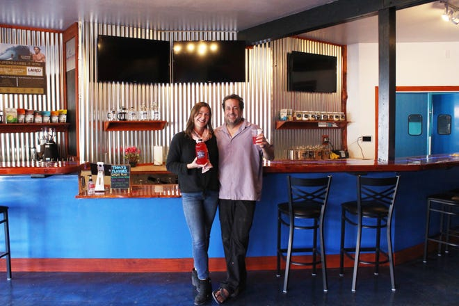 Nion Shepherd and Rebecca Allen, above, stand in front of the newly constructed Alua's Thrive Bar, which has been open for kombucha, and will soon be open for coffee, to-go health foods, and acai bowls.