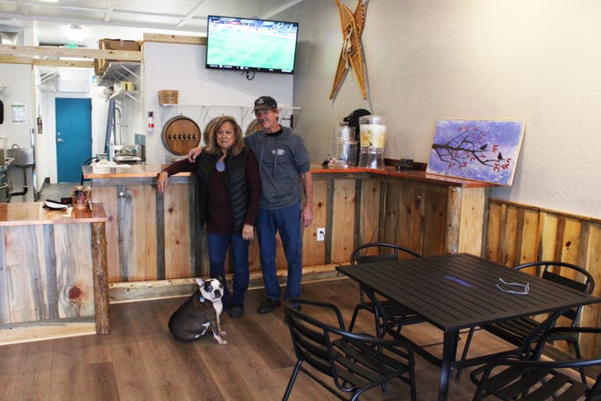 Mt. Shasta Taproom owners Susan and Patric Brush, below, with their dog Lager, are planning to open their restaurant in a few weeks. The Taproom will offer international fare and beers that aren't available anywhere else in the county.