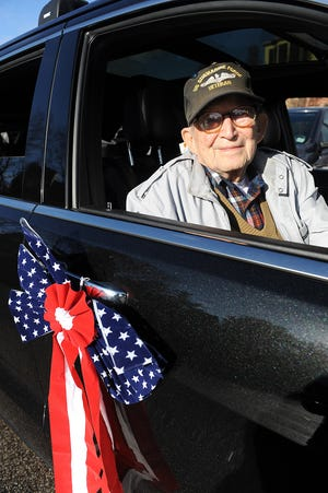 Thomas Carroll, 98, of Natick, a U.S. Navy veteran who served aboard the submarine USS Tarpon, took part in a Veterans Day motorcade drive-by tribute to four nursing home facilities before ceremonies on the town common Nov. 11, 2020.