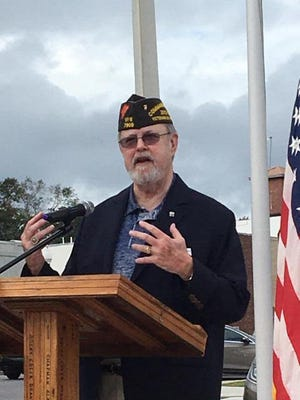 """Go hug a veteran,"" Marine Corps and Vietnam War veteran John Hamilton told more than 200 people at Crestview's Veterans Day ceremony."