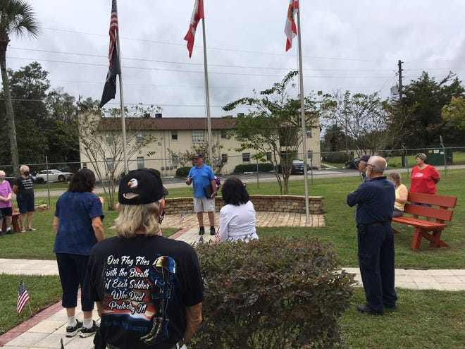 This was the scene Wednesday at The Springs RV Resort, where people gathered on Veterans Day to add two new commemorative bricks to the community's memorial.