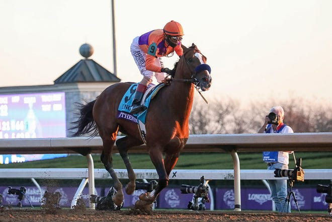 Nov 7, 2020; Lexington, KY, USA; John Velazquez aboard Authentic (9) crosses the finish line after winning the Breeders' Cup Classic during the 37th Breeders Cup World Championship at Keeneland Race Track. Mandatory Credit: Katie Stratman-USA TODAY Sports