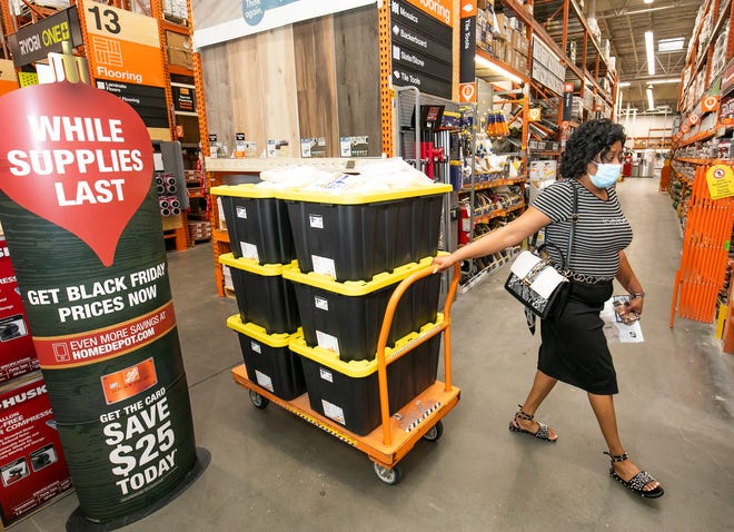 Jena Woodyard, executive director of Eagle Medical Management, was at Home Depot on Wednesday grabbing storage containers for their group home in case there was any flooding from Eta.