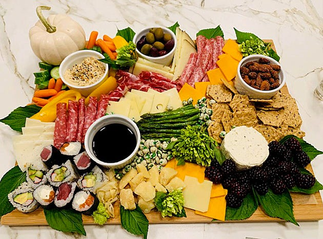 Grazing tables from pbsharkuterie are designed on a tabletop or countertop in a customer's home or business.
