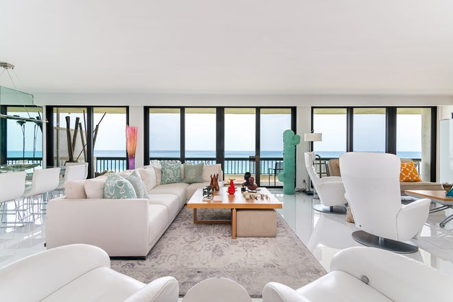 A wall of sliding-glass doors showcases the ocean view in the main living area of Mark Weissberg's southeast-corner condominium in Beach Point. The two-bedroom unt is listed for sale at $2.249 million.