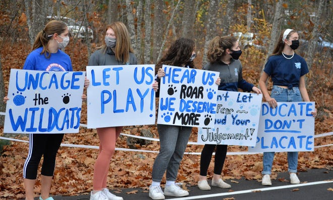 York High School students stand alongside Webber Road near the back of the school entrance during Wednesday's rally against the administration on how it has handled sports this fall.