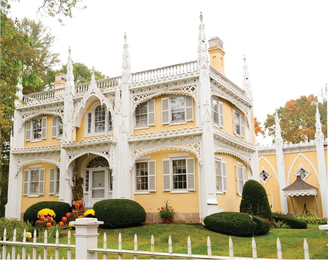 The Wedding Cake House in Kennebunk was built by shipbuilder George W. Bourne in 1825 in the Federalist style. The decorative trim, inspired by the spires and buttresses of the Cathedral in Milan, was added in the 1850s.