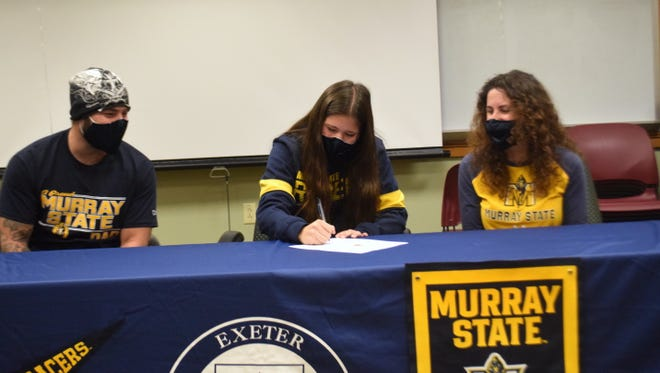 Exeter High School senior Ella Fraser, center, signs a National Letter of Intent to play women's soccer at Murray State University. Ella was joined at the school's signing ceremony Tuesday by her father Jamie, left, and mother Tara.