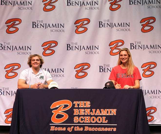 Molly Eversmann, right, and Trevor Natalie pose for a photo after signing their national letters of intent Wednesday at The Benjamin School.