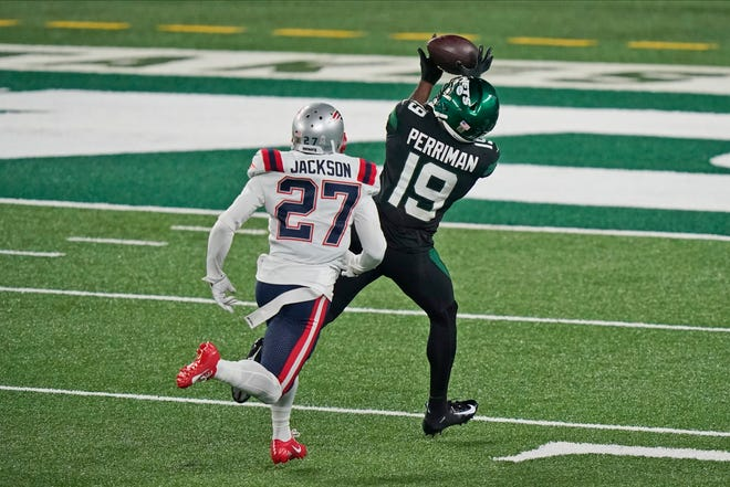 New York Jets' Breshad Perriman, right, catches a touchdown in front of New England Patriots' J.C. Jackson during the first half of an NFL football game, Monday, Nov. 9, 2020, in East Rutherford, N.J.