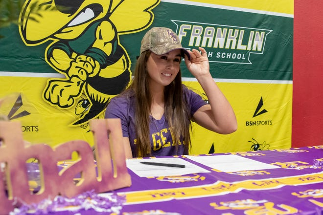"Franklin High School softball player Sydney Peterson tips her LSU hat after signing the letter of intent to play for LSU while her mother Heather, right, watches at the Game Changer Academy in Stockton on Wednesday. ""It means everything that I've done, the hard work, the sweat, the tears, is putting into this moment,"" Peterson said of signing to LSU. ""My dreams are officially coming true. I've waited for this since I was 6 years old."""