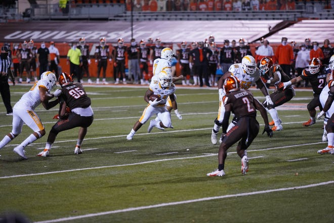 Kent State's Marquez Cooper carries the ball against Bowling Green on November 10, 2020.