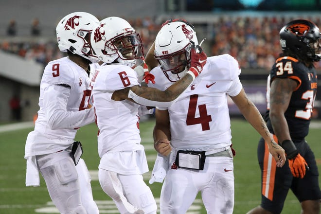 Washington State wide receivers Jamire Calvin (6) and Renard Bell celebrate after quarterback Jayden de Laura (4) ran for a touchdown in last Saturday's 38-28 win at Oregon State.