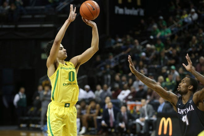 Oregon's Will Richardson shoots a 3-pointer over Montana's Sayeed Pridgett last season. The junior guard is the Ducks' top returning long-range shooter. (Chris Pietsch/The Register-Guard)