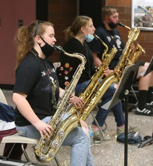 Araya Fowler practices with the concert band at McKinley High School in Canton. The Bluecoats are offering Canton City School and EN-RICH-MENT Academy of Fine Arts music and dance students free access to their educational programming.