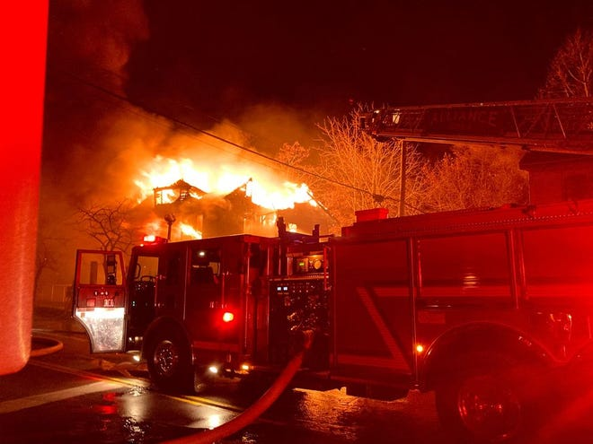 Four people, including a baby, were injured during a fire late Tuesday in Alliance.