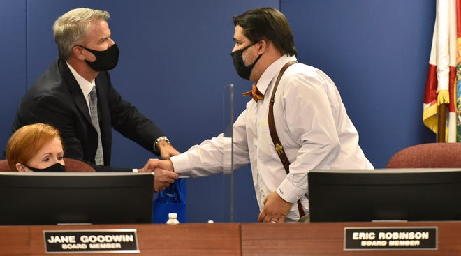 """Sarasota County Schools Superintendent Brennan Asplen thanked Eric Robinson on Tuesday evening for his contributions during his tenure on the board, in particular for his """"Robinson work days,"""" whenhe would spend time working in various district positions, including cafeteria worker, bus driver and custodian."""