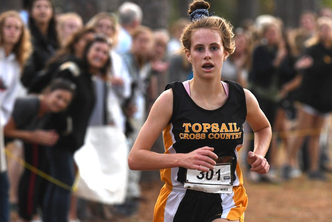 Topsail's Kaitlyn Obremski comes in 1st place for the girls during the MEC Cross Country Championships Thursday Oct. 24, 2019 at Hugh MacRae Park in Wilmington, N.C.