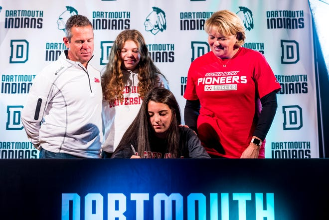 Dartmouth's Kelly Mederios signs her National Letter of Intent to play soccer at Sacred Heart with her family there in support.  (L-R) Matt Mederios, Kristen Mederios, Kelly Mederios, and Jo Ann Mederios.  [RYAN FEENEY/STANDARD-TIMES SPECIAL/SCMG]