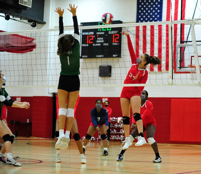 New Bedford's Kayla Medina Soares returns the ball over to Dartmouth during a game at New Bedford.