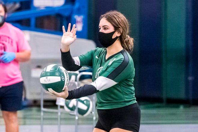 Hannah Bouvier prepares to serve for Dartmouth.