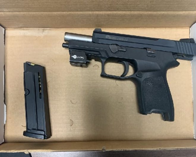 Sig Sauer P250-22 (.22 caliber pistol) seized by New Bedford Police during traffic stop