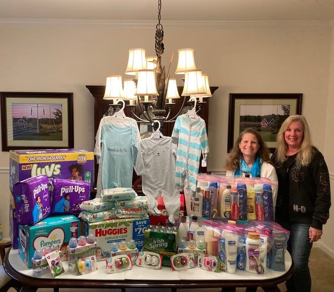 Z Club members Cindy Winkler and Sonia Lyons with items collected for DAPI