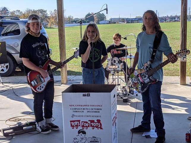 Local rock band Hope for Success — Drew, Elaina, Alex and Jasper — performed at the Nov. 7 kickoff event held by the Nassau DE local campaign organization for the Marine Toys for Tots Foundation.