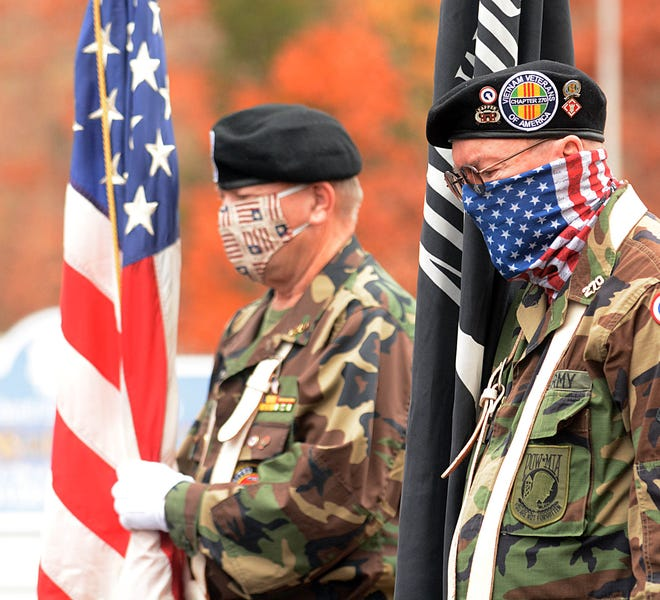 Vietnam War veterans Tom Brown of Lisbon, left, and Clay Sizer of Waterford listen to a prayer Wednesday during Veterans Day at VFW Post 594 in Norwich. See more photos at NorwichBulletin.com [John Shishmanian/ NorwichBulletin.com]