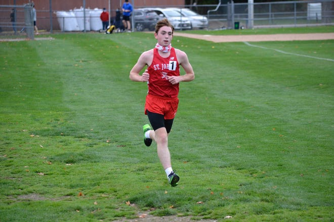 St. John's Connor Gothorpe competes in a cross-country race earlier this season.