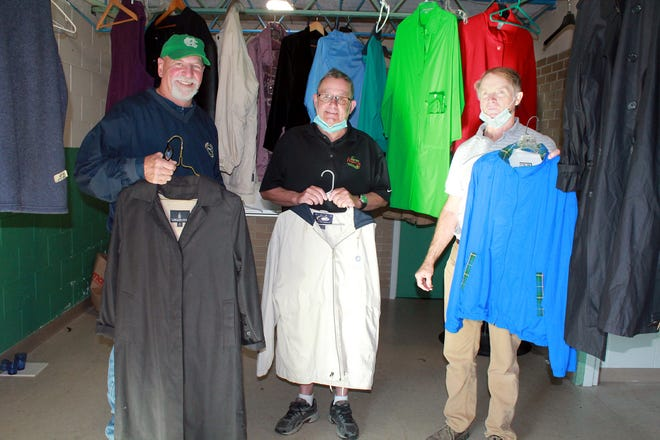The Clinton Knights of Columbus held their coat drive this fall, culminating last Saturday with a distribution of hundreds of coats to people in need. Showing off some of the coats are (from left) Michael Fazio, Joe Blette and John McNally.