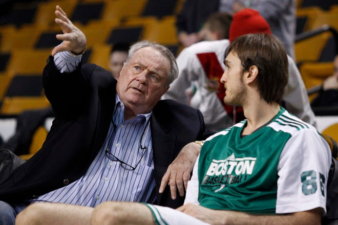 Tommy Heinsohn, left, talks with young Celtics center Semih Erden prior to a game in 2011 against the Sacramento Kings