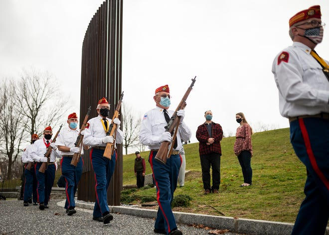 Members of the Worcester Detachment Marine Corps League Color Guard march out of the rededication of Memorial Grove, the city's World War I memorial, on Wednesday in Worcester. View a photo gallery at telegram.com.