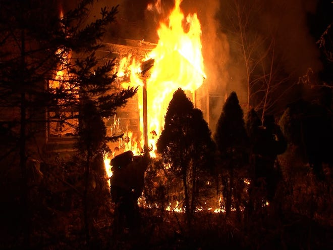 A person died in a three-alarm fire that tore through a house at 31 Glen St., Douglas, late Tuesday.
