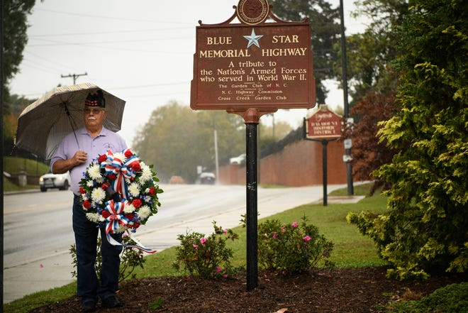 Veteran Don Talbot prepares to lay a wreath at the Blue Star Memorial at Veterans Park on Wednesday. The event was put on by Cross Creek-Briarwood Garden Club.