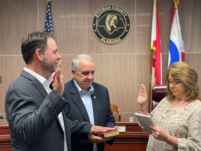 Glenell Grant administers the oath of office as her son, Jamie Grant, takes his position as Etowah County Commissioner for District 3. Johnny Grant — Jamie's uncle — was sworn in as well, after being re-elected as District 2 Commissioner.