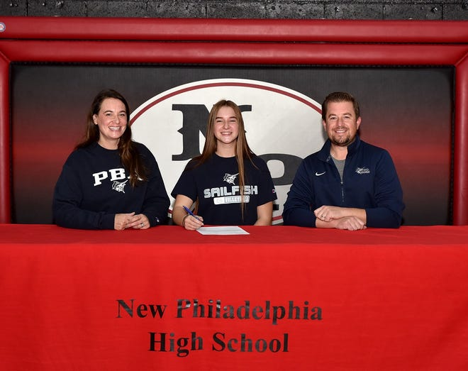 New Philadelphia High School senior middle hitter Madelyn Hooper signs her letter of intent to play college volleyball at Palm Beach Atlantic University, located in West Palm Beach, Fla. PBA is an NCAA Division II member of the Sunshine State Conference. Hooper was a captain her senior year and earned Honorable Mention All-Ohio in Division I, 2nd Team East Central Ohio League and 1st Team District 5 Division I. Hooper is pictured with her  mother Mandy and father Matt.